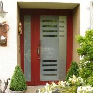 Biffar Haustür Typ S – rote Tür mit Sonderfüllung einschließlich Edelstahl-Innenapplikation